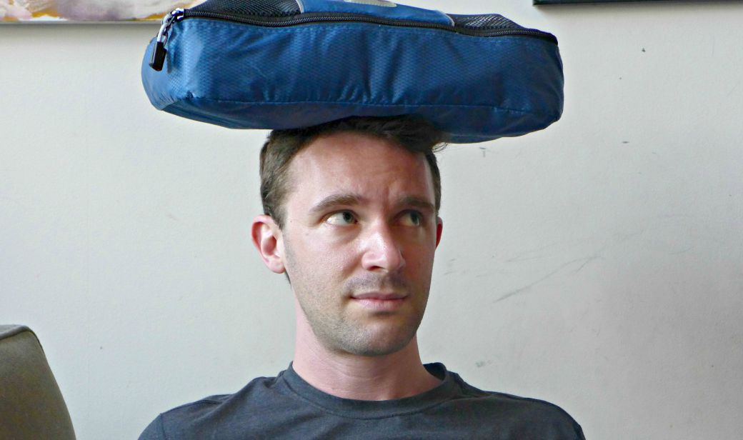 "The packing cube to scale. (Rob's head can be considered ""normal size.)"